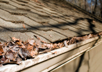 Gutter in need of cleaning by Camelot Pressure Washing